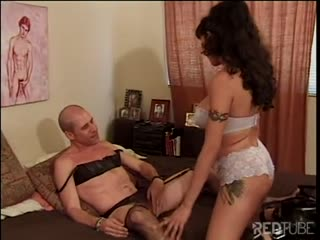 Cross dressing dude fucked with strapon