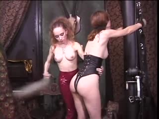 She submits herself  to a playful cruel domme