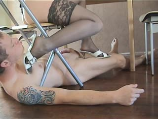 Lady Danira foot stool under her chair