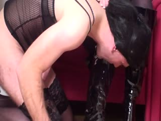 Domina commanding sissy slave to worship her boots