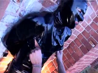 Slave trapped in a latex outfit got her exposed nipple tormented