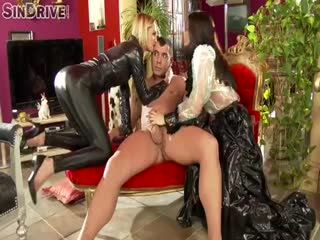Brunette and blonde shares slave outside
