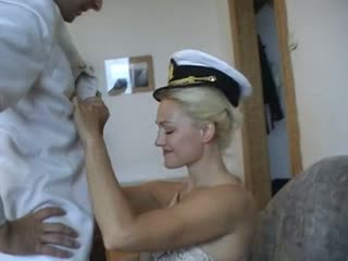 Blonde beauty dominating a sissy sailor