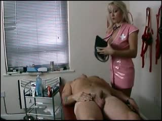 Blonde nurse in pink latex uniform having fun with her patient