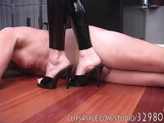 Slave's cock trampled with heels