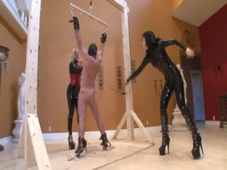 Two Dominatrix Tortured The Man Using The Whip And Ball Busting