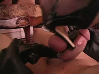 Inflicting pain to his cock with her heels