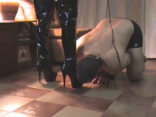 Sophisticated mistress whipping slave relentlessly