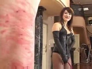Asian sexy mistress happy to see whip marks in slave's body