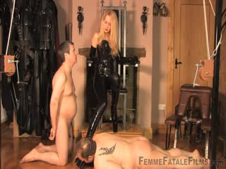 Beautiful blonde in tight latex gets her feet worshipped