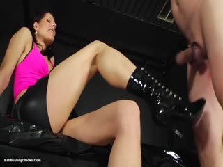 Merciless Mistress adding more pain to a swollen cock and balls