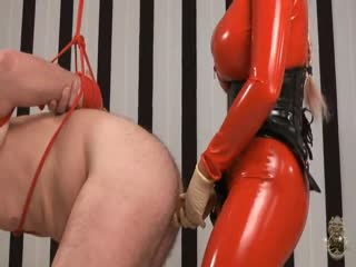 Latex fitted mistress destroys her slaves ass