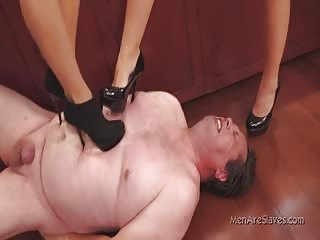 Slave punished in painful heel trampling