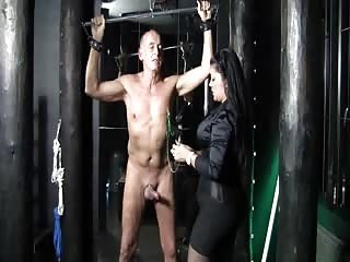 Hand tied up slave get his cock and balls tortured