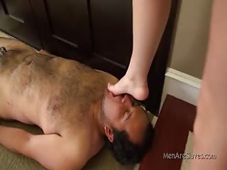 Slave opens   his mouth for mistress  feet