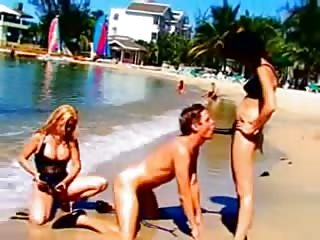 Femdom double pegging at the beach