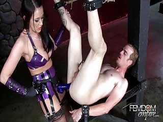 Purple latex mistress and her strapon male slave