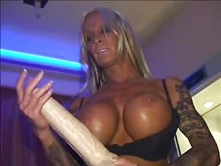 Mature sado mistress with huge black strapon