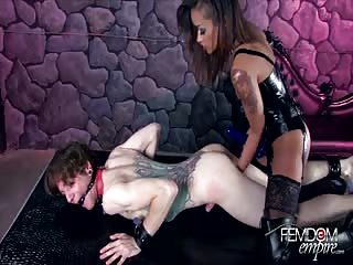 Black latex mistress with white male slave in her private dungeon