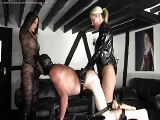 Mistress Nikki and Mistress Rebecca strapon humiliation