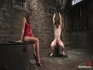 Suspended slave in BDSM scene