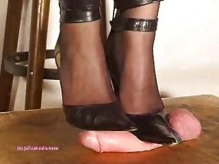 Crushing cock with her black heels