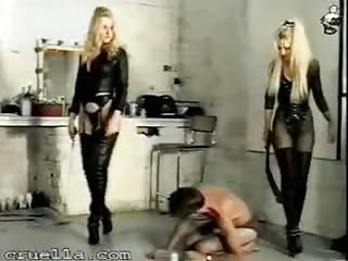 He licks black boots of his mistresses