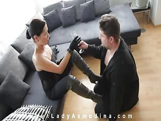 Lady Asmodina dominating with her black boots and feet