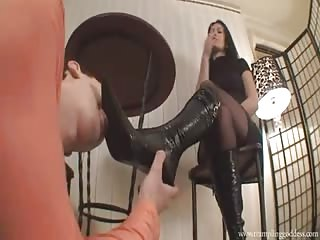 Black pointed boots clean by slave
