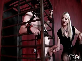 Daily milking routine to a caged slave
