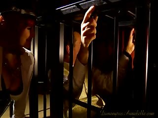 Two strict dommes with caged slave