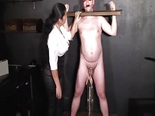 Restrained slave nipples and cock tortured