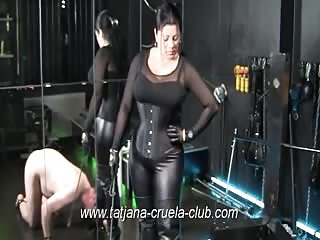 Boot slave serving his mistress