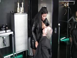 Evil mistress with her old man boot slave