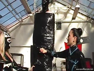Baroness Bijou and friend with their restrained slave