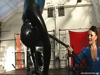 Latex slave hang upside down