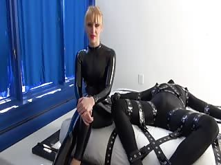 Mistress Carlin uses vibrator to slaves cock