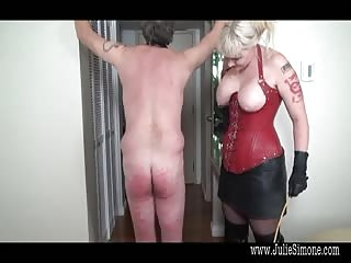 Buxom blonde dominatrix severe caning