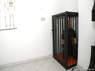 Mistress Baroness Bijou with her caged boot slave