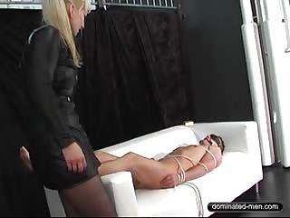 Bondage slave in a white couch