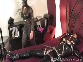 BDSM latex mistress and her latex bounded slave