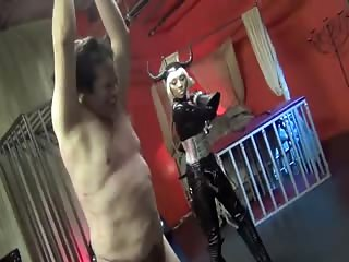 Merciless whipping inflicting to pathetic sub