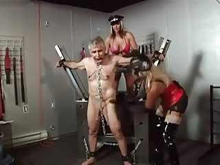 Sado busty chick tormenting an old man slave