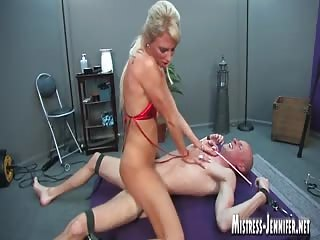 Bound slave dominated by a tall perverted mistress
