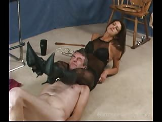 Cruel MILF with nude boots worshiper