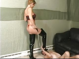 Miserable husband licks her boots like a bitch