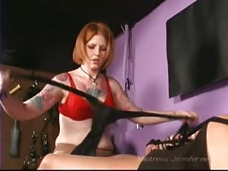 Tattoed red head mistress giving punishment