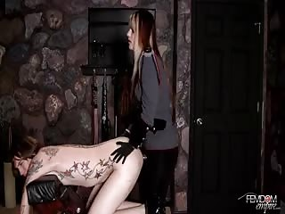 Tattooed slave gets his butt hole fucked