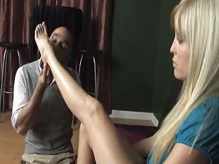 Strict blonde order man to clean her feet with his tongue