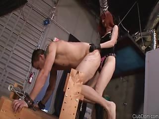 Tall red head domme with black massive strapon